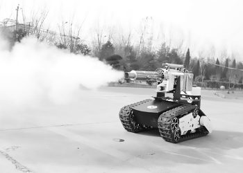 Pic Shows: Weihua Group's disinfectant robot;  These are the new mini robot tanks equipped with diffuser cannons spraying 60 litres of disinfectant every hour and replacing workers who are risking their lives in the fight against the novel coronavirus.